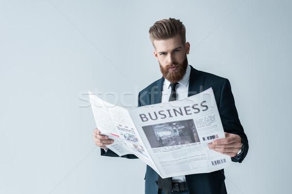 Elegante barbudo empresário leitura jornal cinza Foto stock © LightFieldStudios