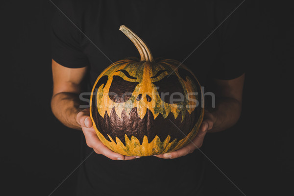 man with pumpkin for halloween in hands Stock photo © LightFieldStudios