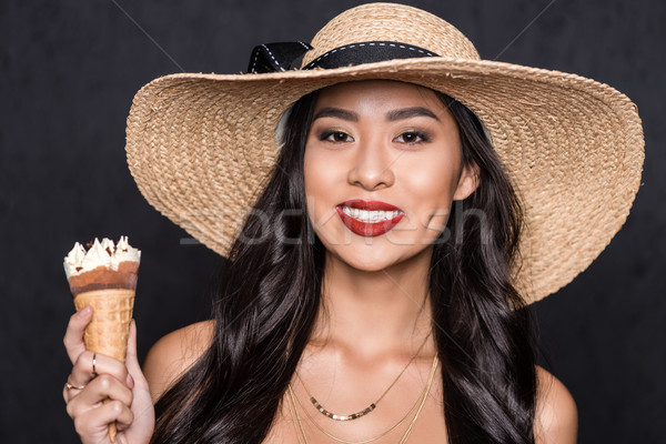 Stock photo: woman in beach hat holding ice-cream