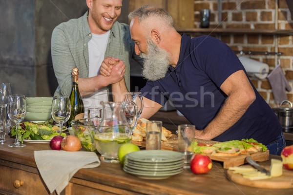 Vader zoon arm worstelen samen zijaanzicht senior vader Stockfoto © LightFieldStudios