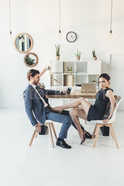 Pár flörtöl iroda nő fekete ruha magassarkú Stock fotó © LightFieldStudios
