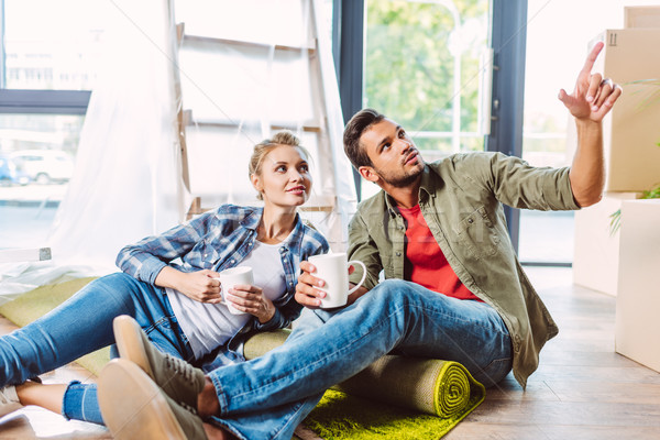 Stock photo: couple drinking tea in new apartment