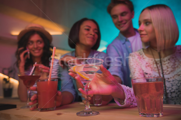 Multicultural amigos fiesta atención selectiva cócteles junto Foto stock © LightFieldStudios