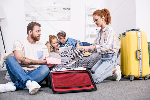 family packing luggage for trip Stock photo © LightFieldStudios