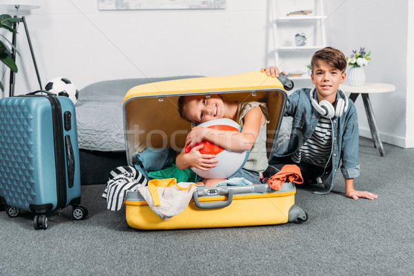 kids packing clothes for trip Stock photo © LightFieldStudios