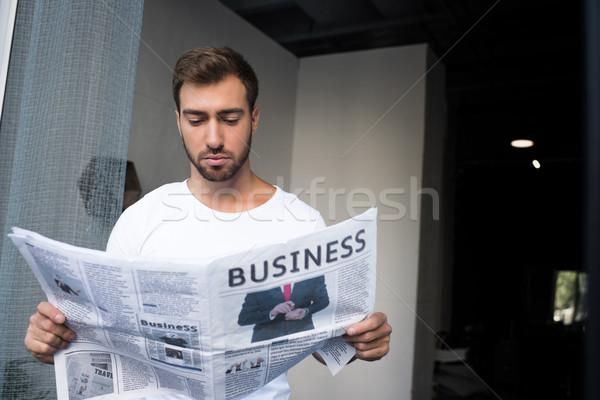 man reading newspaper Stock photo © LightFieldStudios