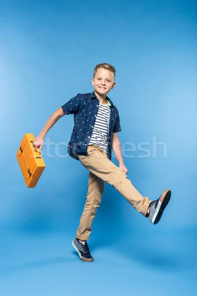 boy with paper briefcase Stock photo © LightFieldStudios