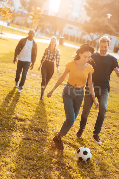 multicultural friends playing soccer Stock photo © LightFieldStudios