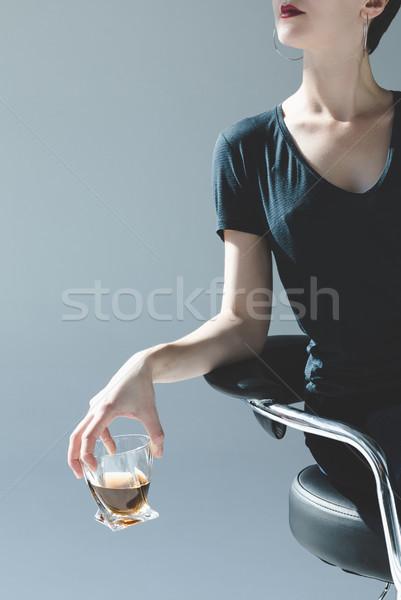 Femme verre whiskey coup élégante Photo stock © LightFieldStudios
