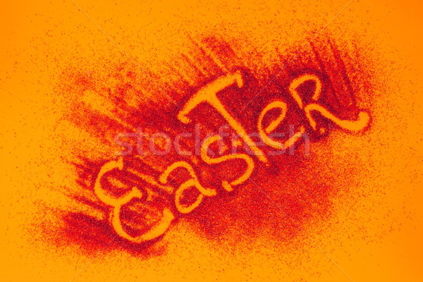 top view of easter sign made of red sand on orange surface Stock photo © LightFieldStudios