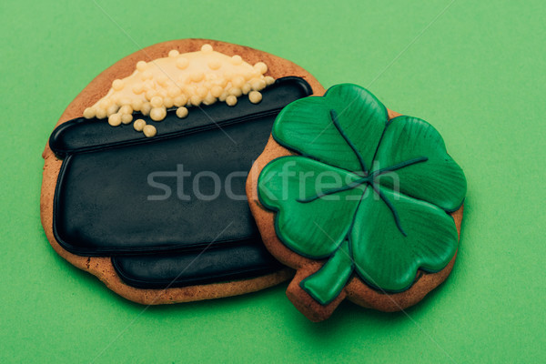 high angle view of icing cookies in shape of pot with coins and shamrock on green, st patricks day c Stock photo © LightFieldStudios