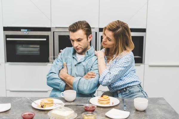 Mujer alterar marido desayuno casa Foto stock © LightFieldStudios