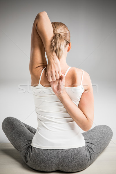 Athletic woman stretching Stock photo © LightFieldStudios