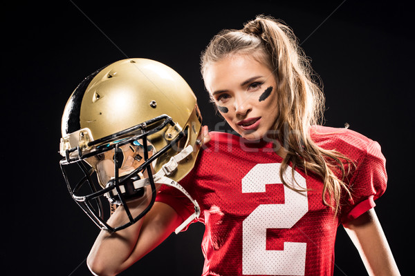 Female football player posing with helmet Stock photo © LightFieldStudios