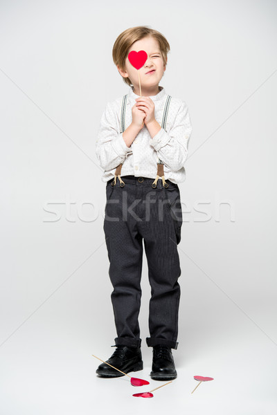 Boy with red heart sigh Stock photo © LightFieldStudios