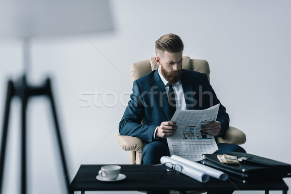 portrait of concentrated businessman reading newspaper in office Stock photo © LightFieldStudios