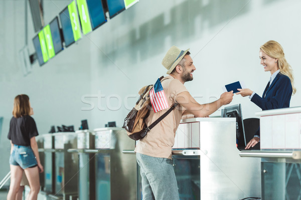 man at check in desk at airport Stock photo © LightFieldStudios