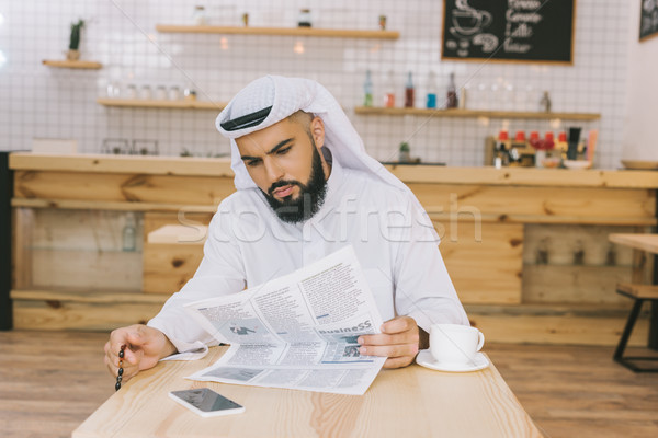 muslim man reading newspaper Stock photo © LightFieldStudios
