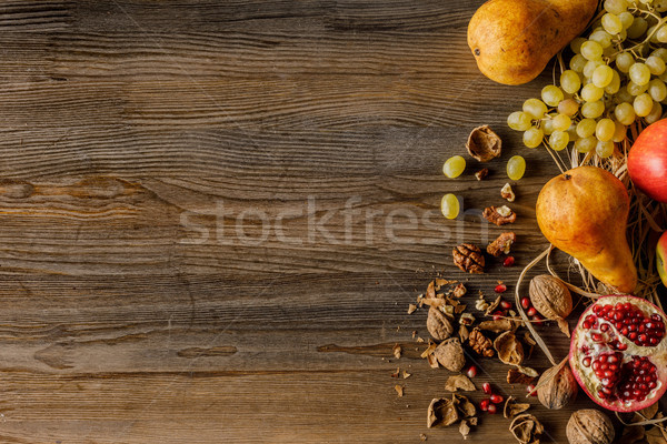 autumnal fruits and walnuts Stock photo © LightFieldStudios