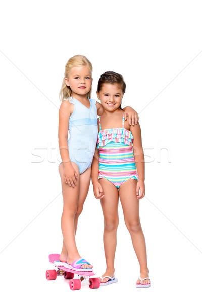 Uśmiechnięty dzieci deskorolka godny podziwu dziewczynka strój kąpielowy Zdjęcia stock © LightFieldStudios