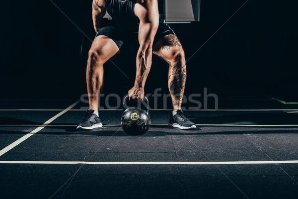Sportoló emel kettlebell lövés fiatal sportos Stock fotó © LightFieldStudios