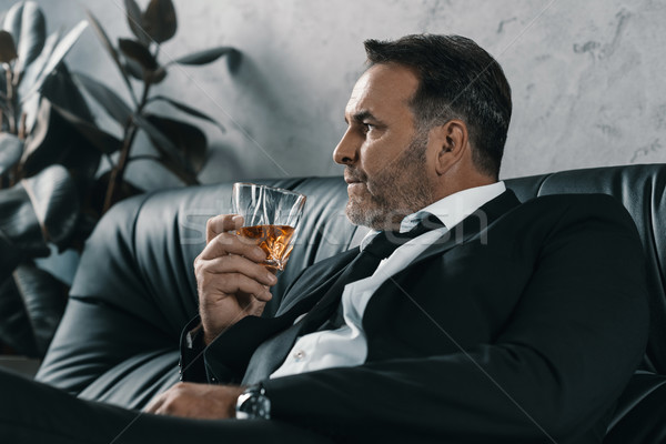 Affaires verre whiskey maturité séance canapé Photo stock © LightFieldStudios