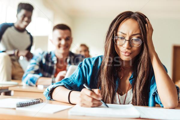 student girl studying in classroom Stock photo © LightFieldStudios