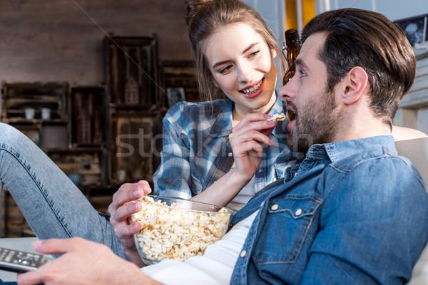 Kobieta chłopak młodych uśmiechnięta kobieta popcorn Zdjęcia stock © LightFieldStudios