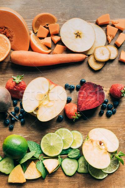 Friss nyers gyümölcsök zöldségek felső kilátás Stock fotó © LightFieldStudios