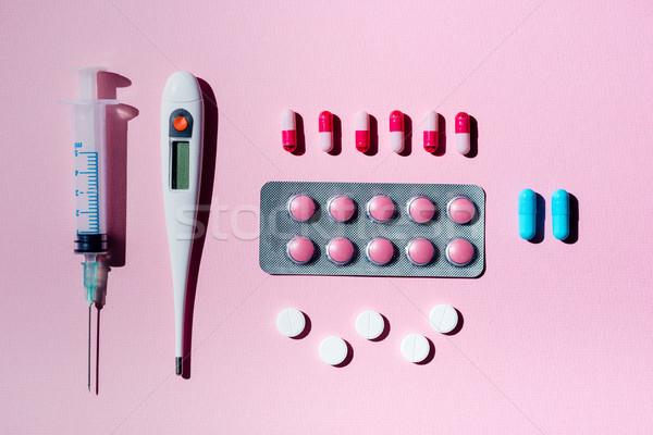 Pillole termometro siringa top view medicina Foto d'archivio © LightFieldStudios
