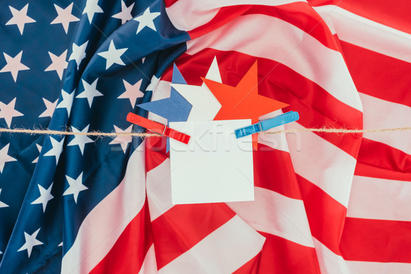 flat lay with american flag, stars and blank paper hanging on rope, presidents day concept Stock photo © LightFieldStudios