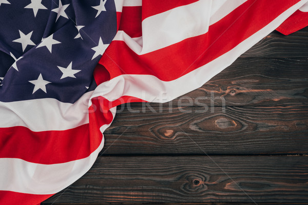 top view of folded american flag on dark wooden tabletop, presidents day concept Stock photo © LightFieldStudios