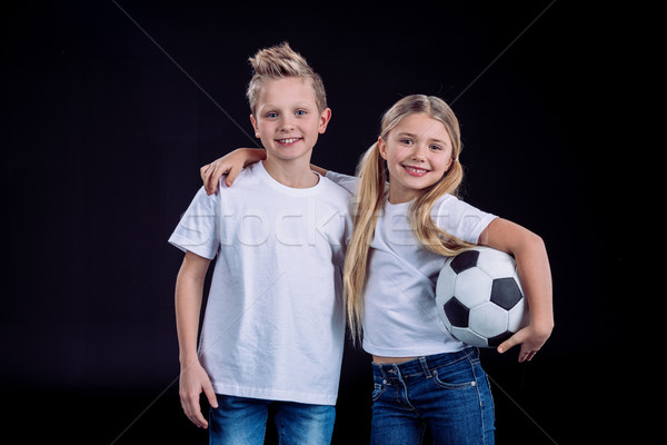 brother and sister posing with soccer ball Stock photo © LightFieldStudios