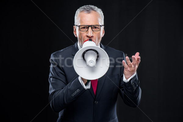 Mature businessman with loudspeaker Stock photo © LightFieldStudios