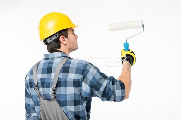 Workman with paint roller   Stock photo © LightFieldStudios
