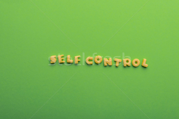 self controt concept,  words made of cookies isolated on green. healthy lifestyle and healthy living Stock photo © LightFieldStudios