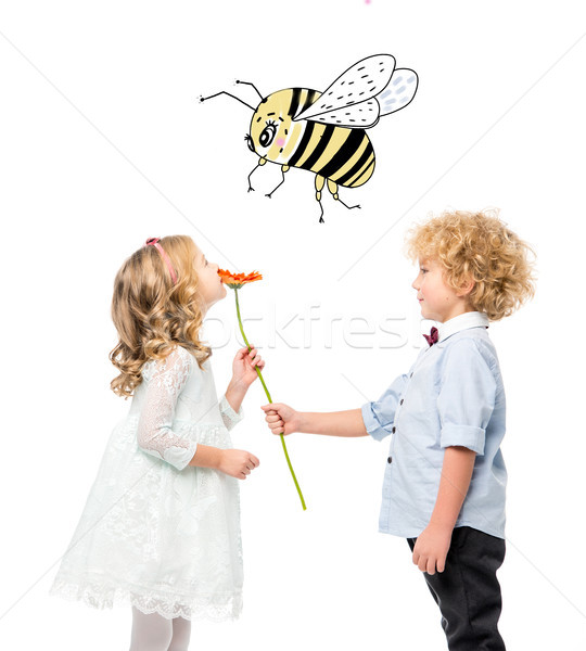 kids with flower and bee Stock photo © LightFieldStudios