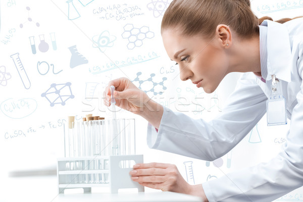woman scientist working at laboratory Stock photo © LightFieldStudios