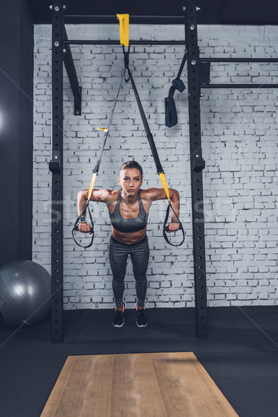 Stock photo: woman doing TRX Suspension Training
