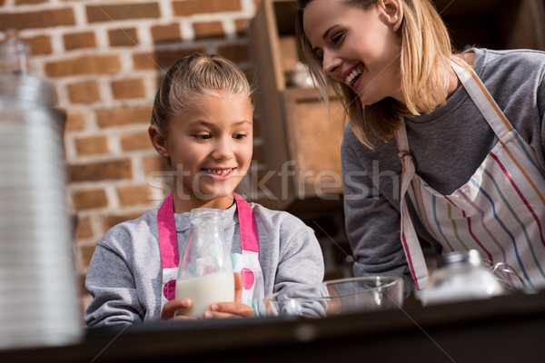 mother and daughter making cookies Stock photo © LightFieldStudios