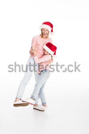 Stock photo: mother and daughter hugging on christmas