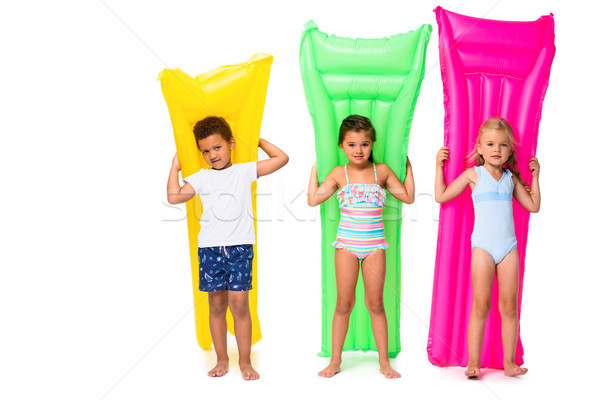 multiethnic kids with swimming mattresses Stock photo © LightFieldStudios