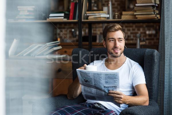 man reading newspaper at home Stock photo © LightFieldStudios