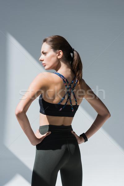 Fiatal nő sportruha hátulnézet gyönyörű áll kezek Stock fotó © LightFieldStudios