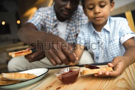 woman grating cheese Stock photo © LightFieldStudios