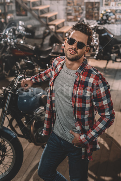 motorcyclist in sunglasses with classic motorbike Stock photo © LightFieldStudios
