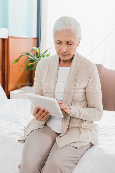 senior woman with digital tablet in hospital Stock photo © LightFieldStudios
