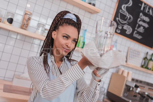 barista wiping glass with towel Stock photo © LightFieldStudios