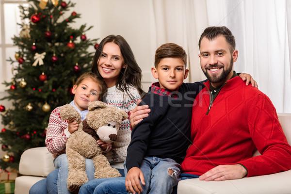 Boldog család karácsony kettő gyerekek plüssmaci mosolyog Stock fotó © LightFieldStudios