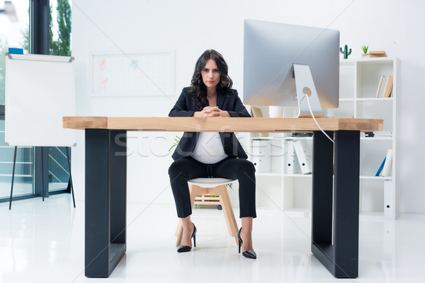 serious pregnant businesswoman at workplace Stock photo © LightFieldStudios